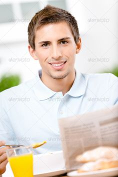 Reading man eats dieting breakfast in kitchen ...  One Person, One object, adult, attractive, breakfast, brown hair, caucasian, cheerful, citrus, color, cute, data, diet, dish, drink, eat, eating, entertainment, food, glass, healthy eating, information, joy, juice, kitchen, leisure, lifestyle, lunch, male, man, meals, morning, news, newspaper, nutrition, orange, paper, plate, portrait, positive, pretty, read, sits, sitting, smile, smiling, snack, table, vitamin, young
