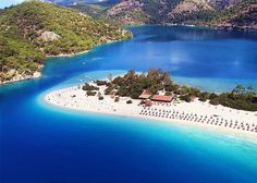 Olu deniz,Turkey. One of the nicest resorts in Turkey. Not too big, but with a good choice of hotels and restaurants. Very hot and very sunny in the summer, but you can escape into the mountains nearby for cooler air.