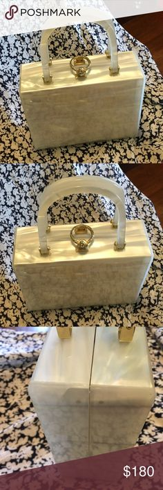 Vintage Stylecraft Lucite Mother of Pearl Handbag Mother of pearl lucite bag dates back to the 1950s. Beautiful goldtone hardware and clasp. The interior is a plastic type material. See photos for any minor blemishes. Stylecraft of Miami Bags Satchels