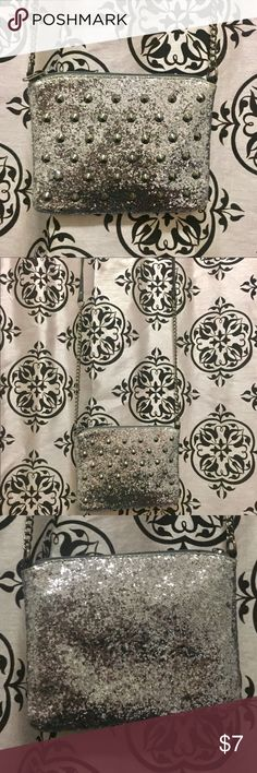 Xhilaration: silver glitter crossbody bag w/studs Xhilaration: silver glitter crossbody bag w/studs.  Used-in Good condition.  Rarely used it. Xhilaration Bags Crossbody Bags