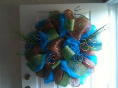 """Dazzling Home Designs by Jodi     24"""" Compentary Wreath - Indoor or Outdoor - Includes Solid Brown Metallic Mesh, Tourquoise Satin Fabric, & Green Mesh Ribbon accented by Tourquoise, Brown & Green Accessories ( Price $65.00)"""