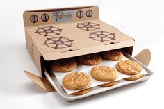 Thelma's cookies are straight out of the oven! The packaging for this cookie delivery business has been designed to look like an old fashioned stove-top-oven and the cookies laid out on baking sheets. Now, how to add some heat? Clever Packaging, Cookie Packaging, Food Packaging Design, Brand Packaging, Packaging Ideas, Product Packaging, Innovative Packaging, Packaging Solutions, Jam Packaging