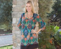Batik dress and a monogram necklace by @Stylish Housewife