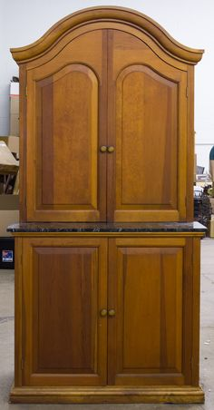 Lot 117: Pine Cabinet with Slate Counter; Two piece built-in cabinet with double wood panel doors over slate surface over double wood panel doors