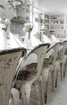 Love rustic metal chairs and wood