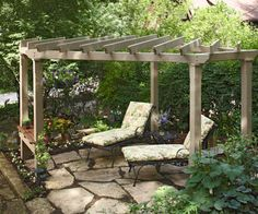 like the double outside posts w/ tables built between them as well as the angle of the rafters (and the flagstones for that matter -- do we want to consider extending them from our current path?)