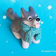 """Winter Wolf catching snowflakes :) #wolfart #wolfsculpture #polymerclay #sculptedpups #wolf"""