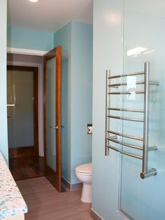 Colors and towel bar.The designer of this contemporary guest bath tried several shades of blue before settling on a rich Caribbean hue that makes the space. Asian Bathroom, Bathroom Spa, Master Bathroom, Bathroom Ideas, Modern Baths, Contemporary Bathrooms, Heated Towel Bar, Green Mosaic Tiles, Bamboo Mirror
