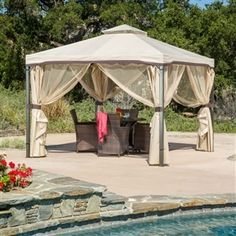 This 10' x 10' Steel Frame Gazebo with Polyester Canopy and Screen in Beige adds a functional touch to any outdoor living space. The steel frame of the gazebo is durable and comes with adjustable netting to enclose the gazebo.
