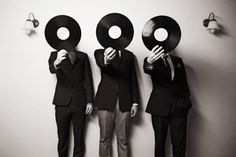 Surrealistic band photo by Karen McBride. Looks like a René Magritte painting