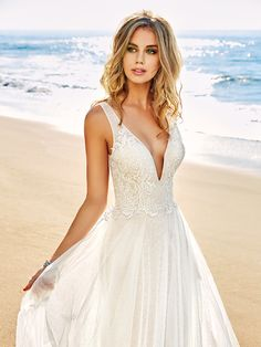 In the wedding world, laid-back doesn't have to mean completely casual, you guys. So if you want to walk down the aisle in a gorgeous bohemian number, but don't want to give up your princess dreams, we suggest checking out all of the lovely gowns from the newest Simply Val Stefani Collection. #weddingdress