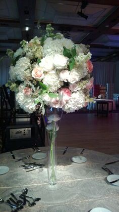 stunning tall centerpiece is soft pink and peach