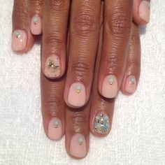 Nude nails with a magical unicorn and crystals...