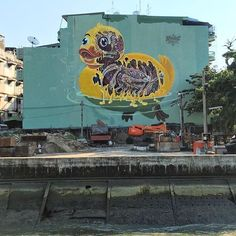 #Inspiration  Rubber ducky melting into the rivers of #Bangkok #Nychos #TheWeird #TheMuralCo