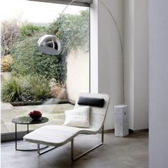 i'm really digging midcentury arc floor lamps.