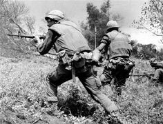 """Photo tag:"""".... Tom Dreiling ©Stars and Stripes South Vietnam, May, 1967: U.S. Marines fire as they charge against a North Vietnamese position near Con Thien during Operation Prairie IV....."""" Via ~ The NAM (tag cred ~ Bob B.)"""