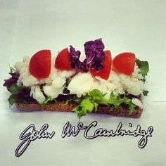 McCambridge brown bread with fresh crab meat and baby tomatoes sitting on a bed of crispy lettuce, scrumptious!