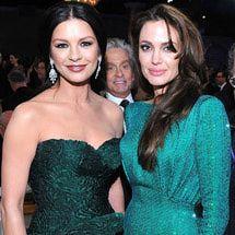 20 Funny Celebrity Photobombs That Were Instant Classics: Who Wants A Jolie and Zeta Jones Sandwich?