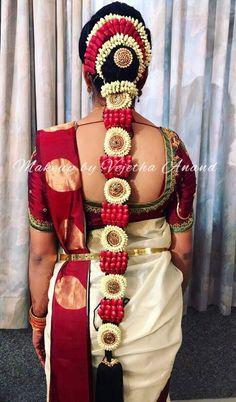 South Indian bridal hair. Braids. Bridal hairstyle. Hair accessories. Fresh flowers. Saree blouse design.