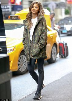 Zendaya dons a camouflage hoodie with leggings for NYC dinner She's got star power: Zendaya cut a stylish figure in an oversized camouflage hoodie with black leggings on Monday in New York City Zendaya Mode, Moda Zendaya, Zendaya Outfits, Zendaya Style, Mode Outfits, Fall Outfits, Casual Outfits, Fashion Outfits, Zendaya Fashion