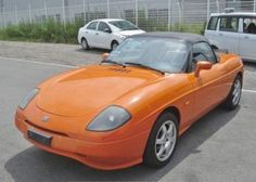 Fiat Barchetta BARCHETTA 1.8 CONVERTIBLE * RARE ORANGE * LHD * LOW MILEAGE * FRESH IMPORT Convertible Petrol OrangeFiat Barchetta BARCHETTA 1.8 CONVERTIBLE * RARE ORANGE * LHD * LOW MILEAGE * FRESH IMPORT Convertible Petrol Orange at The Car Warehouse Middlesbrough