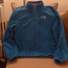 The North Face - Soft Zip Up Jacket  Super soft and warm, The a North Face Jacket in Size Large. Beautiful Turquoise Blue with The North Face insignia and logo on both front and back shoulder in Silver color.  This is in excellent condition!  It's perfect for the rest of the cold days and well into Spring for outdoor activities. Like, um...Baseball !! The North Face Jackets & Coats