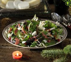 Thursday's New Year Eve recipe: green salad with xinomizithra cheese, almonds and cranberry sauce. The fresh vegetables and cool xinomizithra cheese are perfectly combined with the sweet fruit to offer us a colourful salad. It whets your appetite for a delicious new year! http://www.yolenis.com/4118/green_salad_with_red_onions_almonds_and_cranberry_sauce #thursdayrecipe #yolenistaste #salad