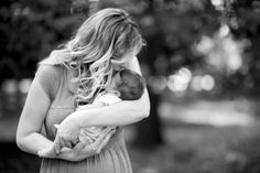 Mother with her newborn redheaded son during family portraits, surrounded by gorgeous trees (black and white)