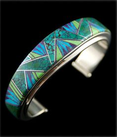 Cuff   Julius Burbank.  Sterling silver set with turquoise, gaspeite and sugilite.