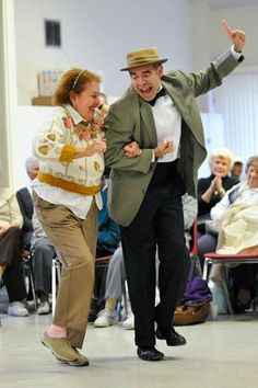 Raul Nieves of Dance Caliente dances with Medford resident Maria Cusick at the Medford Senior Center.