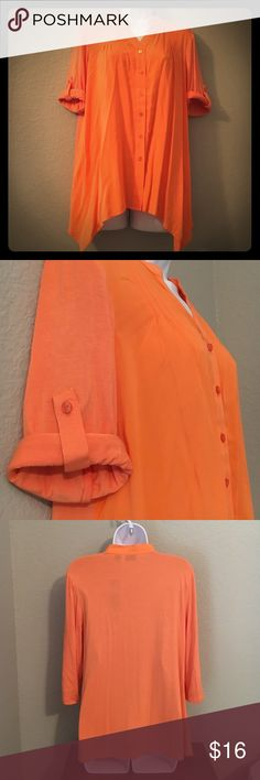 """Orange Blouse NWT! Pumpkin orange blouse with convertible sleeves. Roll the sleeves up and secure with a button or wear down. Front of shirt is rayon/spandex and the sleeves and back are rayon. Very soft and flows. Great for work or going out. Petite Small. 25 1/2-28"""" length, 19 1/2"""" armpit to armpit. Tops Blouses"""