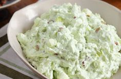 Watergate Salad recipe...The ultimate potluck hit...and the only dish on the table with the delicious mix of mouthwatering pineapple, fluffy marshmallows and creamy pudding. Beat that, coleslaw!