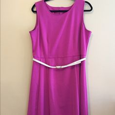 """Fuchsia pink A-line dress. Fuchsia pink A-line dress. Slightly thicker material. I have worn it several times in the summer and in the fall with a cute cream eyelet sweater. Measures 23"""" from belt line so right to the knee for me at 5'6"""". Also the chest is 20"""" across. Please ask if you have any questions. Thank you for looking. 212 Dresses"""