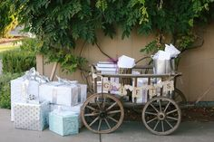 """This gift receiving area offers the """"wow"""" factor at any rustic vintage wedding reception. A unique and hard-to-find piece, our goat cart from Germany makes a statement like no other, with our """"Gifts""""  banner in vintage sheet music paper  and laser-cut wood framed letters. Vintage wedding rentals from AmericanVintageRentals.com"""
