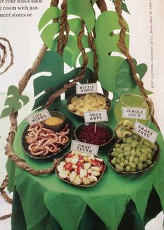 Jungle theme end of year party cute food ideas. (Shown: Hot dogs, apples, grapes, raisins, chips, sports drink)