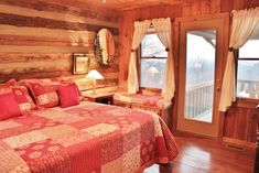 The master suite is located on the main level and features a private bath and access to the screened back porch and views. Log Cabins For Sale, Cabins In The Woods, Bed N Bath, Log Cabin Homes, Cottage Interiors, Kids House, House Plans, Bedroom Decor, Master Suite