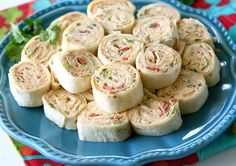 """<p>Mix all of your ingredients in a  large bowl until well blended, spread the mixture evenly over the entire tortilla and roll it up tightly.</p>  <p>Chill the rolls until ready to serve and then slice them up. These are sure to be a crowd favorite!</p>  <p>See full post on <a href=""""http://www.the-girl-who-ate-everything.com/2015/08/chicken-enchilada-roll-ups.html"""" target=""""_blank"""">The Girl Who Ate Everything</a>.</p>"""