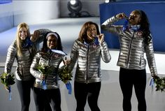Former #Illini track and field sprinter and shot putter Aja Evans (far right) and driver Jamie Gruebel (far left) won a bronze medal for the USA Bobsled team at the 2014 Sochi Winter Olympic games. They're pictured with the USA silver medal team, Elana Meyers and Lauryn Williams. #USA #Sochi2014 @Aja Evans