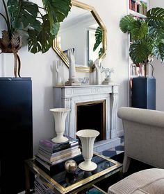Inside an Apartment That's Black and White and Chic All Over// brass frame mirror, palms