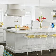 The subway tile in the kitchen is by Walker Zanger, and the pendants are from Rejuvenation. | Coastalliving.com
