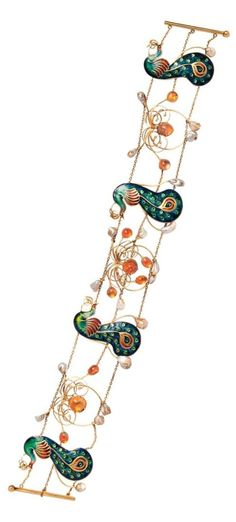 An Arts and Crafts gold, enamel, fire opal and freshwater pearl dog collar, probably English, circa 1905. Designed as four polychrome champleve enamel peacocks with silver paillons interspersed stylised wirework blossoms bezel-set with cabochon fire opals and highlighted by pearls, counter-enamelled, joined by strands of trace link chain, gold mount, unsigned.