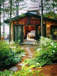 Incredible Pictures: Beautiful tiny house in the woods with green trim. Love the stepping stones, the plants along the path, and the open feeling. (Picture only)