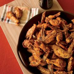 Chicken wing recipes include classic Buffalo wings and Michael Symon's spicy Sriracha chicken wings. Plus more chicken wing recipes. Chicken Wing Sauces, Crispy Chicken Wings, Sriracha Chicken, Chicken Wing Recipes, Sriracha Wings, Hot Wing Sauces, Spicy Wings, Bbq Wings, Sriracha Sauce