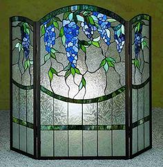 stylish and modern stained glass fireplace screen design for our warmth: curve stained glass firepace screen with upper side blue green leave patterns
