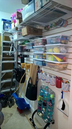 DIY tool room slat wall organization... We used to have a giant shelf unit in this room and still couldn't walk in with all the stuff on the floor. Now there is even more stuff and we can walk around!  Wish I had before and after pictures.  It's a major transformation!