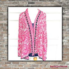 https://www.etsy.com/listing/226647832/tunic-cardigan-batik-blouse-indonesia?ref=shop_home_active_9   Cardigan Batik blouse Indonesia-HOT PINK. Handmade blouse cardigan NO button style.One-of-a-kind-Contemporary batik.Novelty pattern.Yoga top