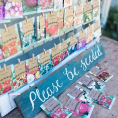 These creative escort cards aren't the only adorable thing in this wedding. Wait til you see the setting! via Gypsy Jane Photography