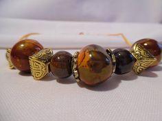 Collier court perles en céramique grecque, orangeai et marron.