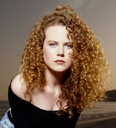 Grow out fine curls and add light layers to make them feel lush and full, like Nicole Kidman did in 1990.   - Redbook.com