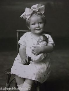 Adorable Little Girl Holding Her Baby Doll Big Bow Real Photo Postcard 1900s